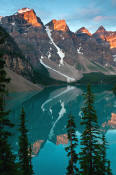 Image of Wenkchemna Peaks reflected in Moraine Lake, sunrise