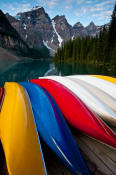 Image of Canoes at Moraine Lake below Wenkchemna Peaks