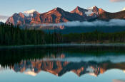 Image of Lake Louise Peaks reflected in Herbert Lake, sunrise