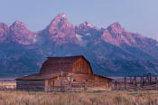 Image of Grand Teton above barn along Mormon Row at dawn, Grand Teton National Park
