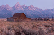 Image of Tetons above a barn on Mormon Row at dawn, Grand Teton National Park